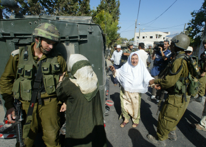 Emad's mother pleads with an Israeli soldier to release her son Khaled after he was arrested.