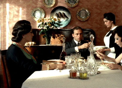 Jean-Louis Trintignant's Marcello Clerici dines at the family home of his fiancee Giulia (Stefania Sandrelli) in Bernardo Bertolucci's THE CONFORMIST. The cinematography is by Vittorio Storaro.