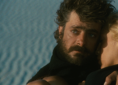 Giancarlo Giannini and Mariangela Melato in SWEPT AWAY.
