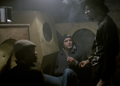 L-R: Errol (David N. Haynes), Ronnie (Karl Howman), Dreadhead (Archie Pool) and Blue (Brinsley Forde) at the Ital Lion clubhouse in Franco Rosso's BABYLON.