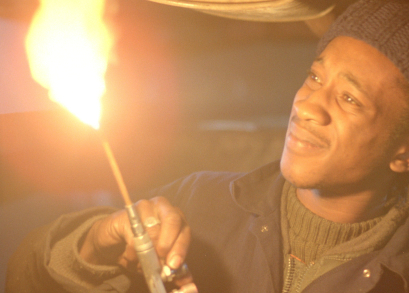 By day, Blue (Brinsley Forde) works as a mechanic in Franco Rosso's BABYLON.