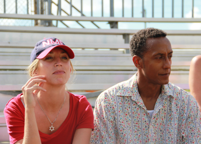 Debbie (Daisy Haggard) and Byrd (Andre Royo) watching Josh's baseball game.