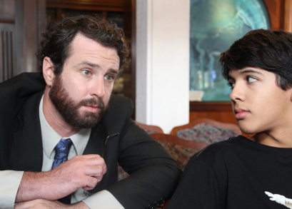 Josh (Luca Oriel) and Rabbi Brookstein (Sean McConaghy) meeting for the first time.