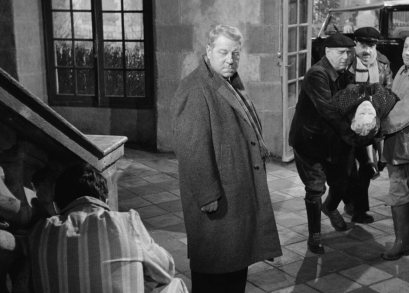 The body of the murdered Countess St. Fiacre (Valentine Tessier) is carried into her home in MAIGRET AND THE ST. FIACRE CASE.