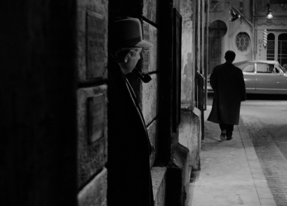 Jean Gabin, as Inspector Jules Maigret, shadows a suspect in MAIGRET AND THE ST. FIACRE CASE.