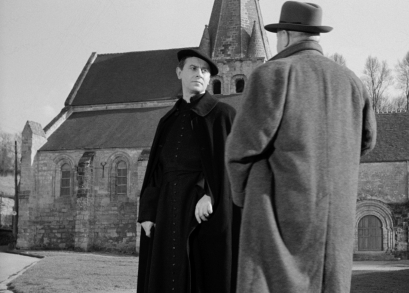 Michel Vitold as Father Jodet in MAIGRET AND THE ST. FIACRE CASE.