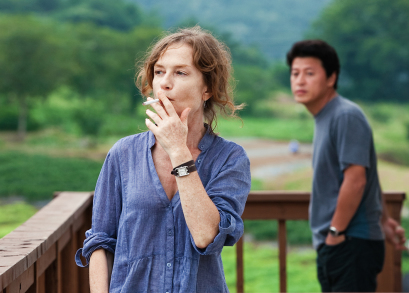 Isabelle Huppert and Yu Junsang in Hong Sang-soo's IN ANOTHER COUNTRY