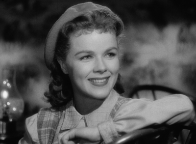 Sally (Sally Forrest) is charmed by Steve (Leo Penn) in Ida Lupino's NOT WANTED.