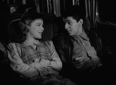Sally (Sally Forrest) and Drew (Keefe Brasselle) meet cute on a long-distance bus trip in Ida Lupino's NOT WANTED.