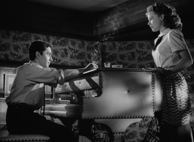 Leo Penn is an itinerant musician and Sally Forrest is the small-town girl who has fallen for him in Ida Lupino's NOT WANTED.