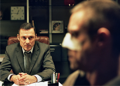 Michel Voita as Commissioner Paoli interrogates 