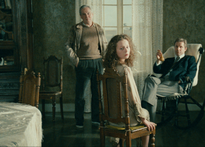 Erland Josephson, Filippa Franzén, and Sven Wollter in Andrei Tarkovsky's THE SACRIFICE.