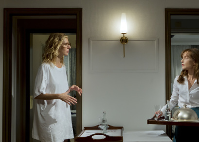 Sandrine Kiberlain as Sally Marinelli and Isabelle Huppert as Esther Lafarge in TIP TOP, a film by Serge Bozon.