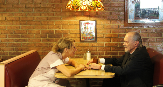 Salomon (Hans Howes) visits Debbie (Daisy Haggard) at the diner.