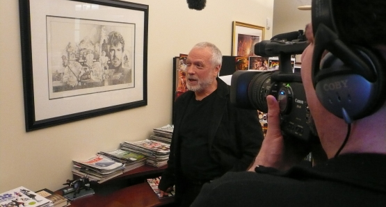 Drew Struzan observing his artwork at Lucasfilm Studios on the set of DREW: THE MAN BEHIND THE POSTER.