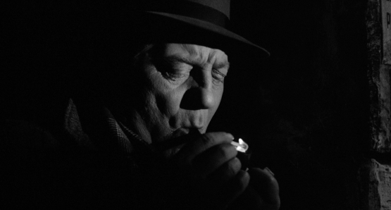 Maigret lights up in MAIGRET AND THE ST. FIACRE CASE.