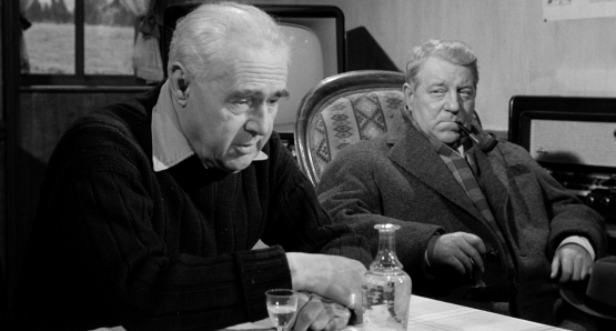 Jean Gabin, as Inspector Jules Maigret, questions Gaulthier (Camille Guérini) in MAIGRET AND THE ST. FIACRE CASE.