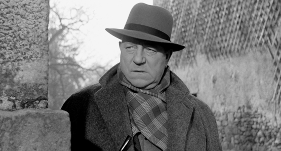 Jean Gabin as Inspector Jules Maigret in MAIGRET AND THE ST. FIACRE CASE.