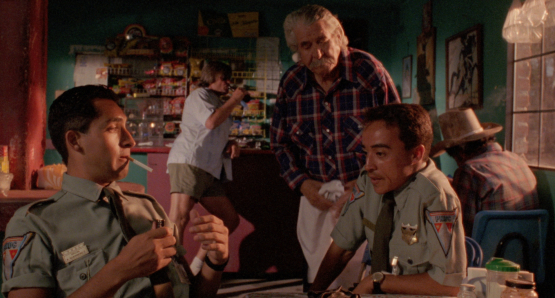 Bruno Bichir as Anibal and Roberto Sosa as Pedro in Alex Cox's HIGHWAY PATROLMAN.