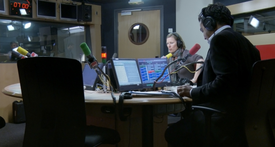Angélique Boulon and Patrick Cohen in LA MAISON DE LA RADIO, a film by Nicolas Philibert.