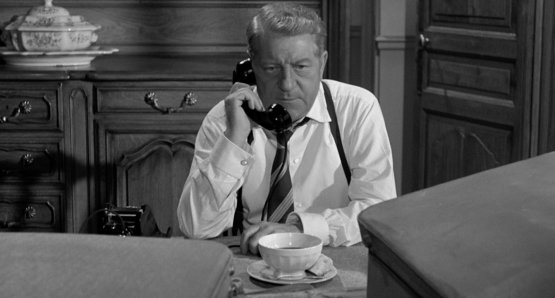 Jean Gabin as Inspector Jules Maigret in MAIGRET SETS A TRAP.