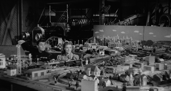 Drew (Keefe Brasselle) shows off his train set to Sally (Sally Forrest) in Ida Lupino's NOT WANTED.