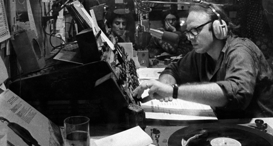 Bob Fass (front), subject of Paul Lovelace & Jessica Wolfson's RADIO UNNAMEABLE (opening September 19 at Film Forum), in his WBAI studio with Abbie Hoffman. Photo by Robert Altman. A Kino Lorber release.